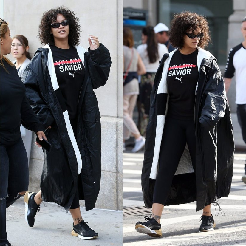 Rihanna Haider Ackermann black hooded parka, Puma villan savior t-shirt and Ignite Dual Gold sneakers