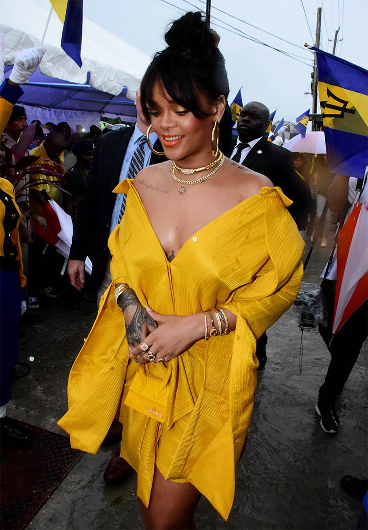 Rihanna Drive Hellessy yellow dress, Manolo Blahnik python mules, Jacquemus le sac chiquito, Jennifer Fisher hoop earrings