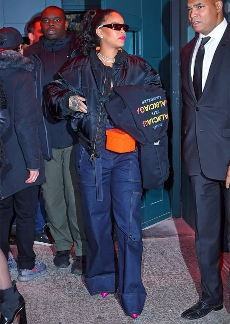 Rihanna Dior shield sunglasses New York, Balenciaga cities hooded sweatshirt, Tom Ford Spring 2018 jeans, Vetements x Alpha Industries black bomber jacket, Chanel makeup train case
