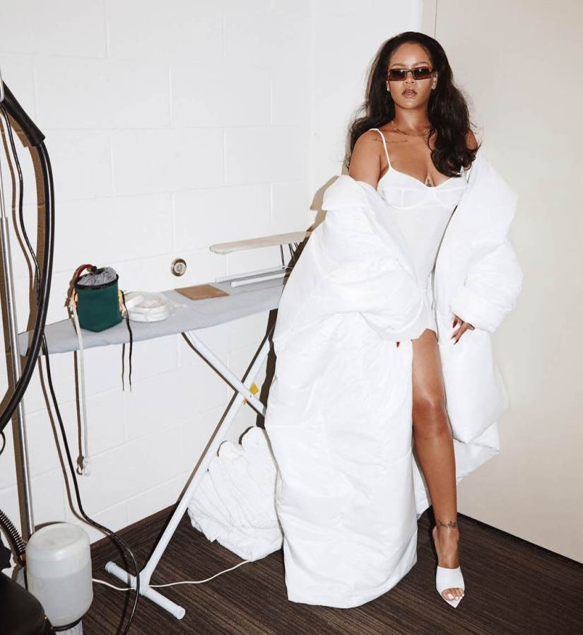 Rihanna Instagram white coat Norma Kamali, Dolce and Gabbana white bustier slip dress, Gianvito Rossi Alise mules, vintage Armani sunglasses
