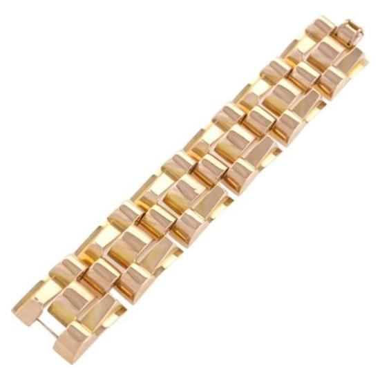 Van Cleef and Arpels yellow and rose gold tank bracelet as seen on Rihanna