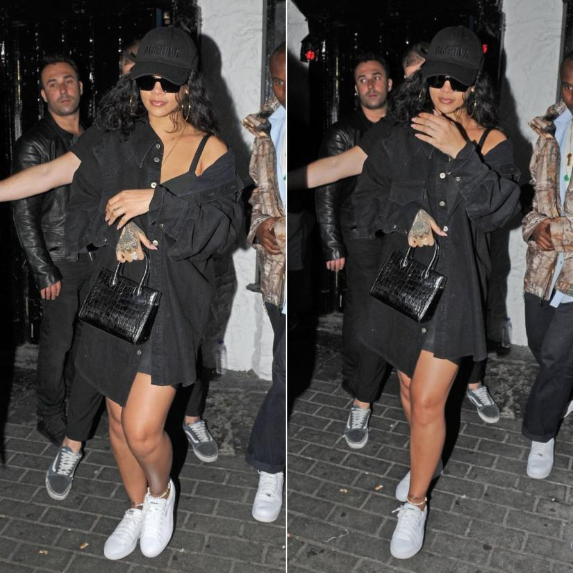 Rihanna Matthew Adams Dolan black denim jacket London, Juun.J black Archive hat, Off-White x Warby Parker large sunglasses, Puma white Basket Classic sneakers, Azzedine Alaia mini tote handbag