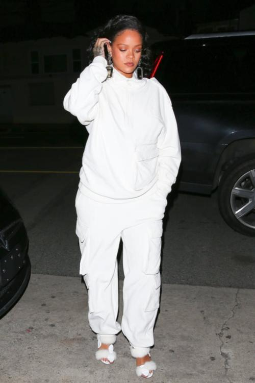 Rihanna Louis Vuitton white cargo pants and half zip sweatshirt, Olgana Paris mink fur sandals, Balenciaga crystal floral drop earrings