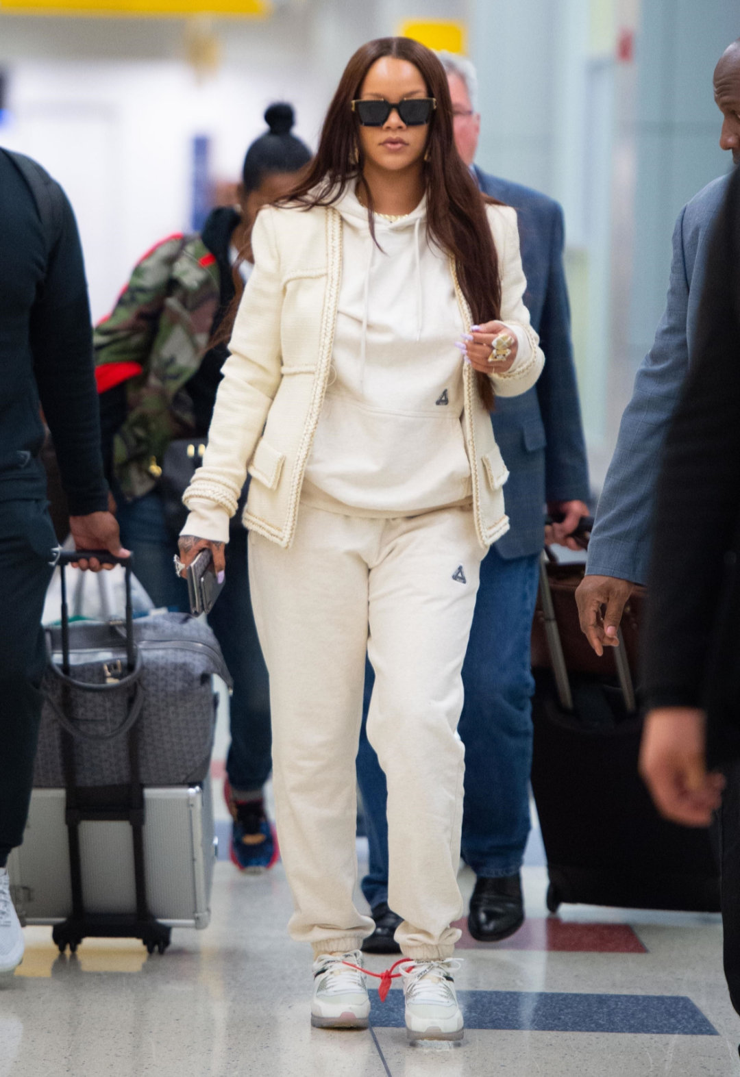 Rihanna Wears Chanel Jacket During Flight to NYC Haus of