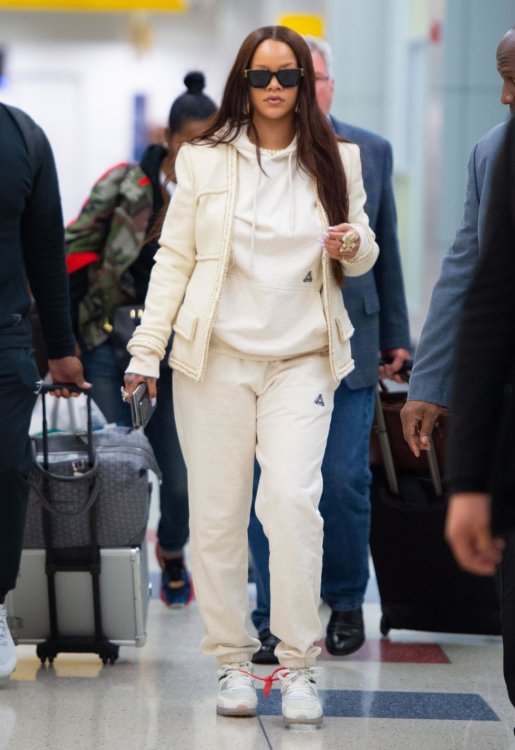 Rihanna Chanel beige jacket JFK airport, Palace Skateboars Sofar oatmean marl hoodie and jogger, Nike x Off-White Air Max 90 sneakers, Louis Vuitton 1.1 Millionaires sunglasses, Goyard passport cover
