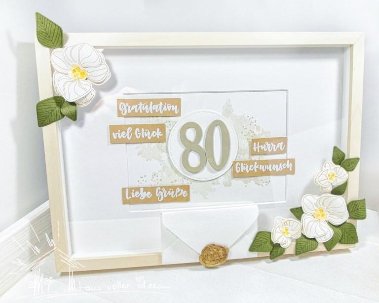 Bilderrahmen mit Orchideen verziert als Geburtstagsgeschenk