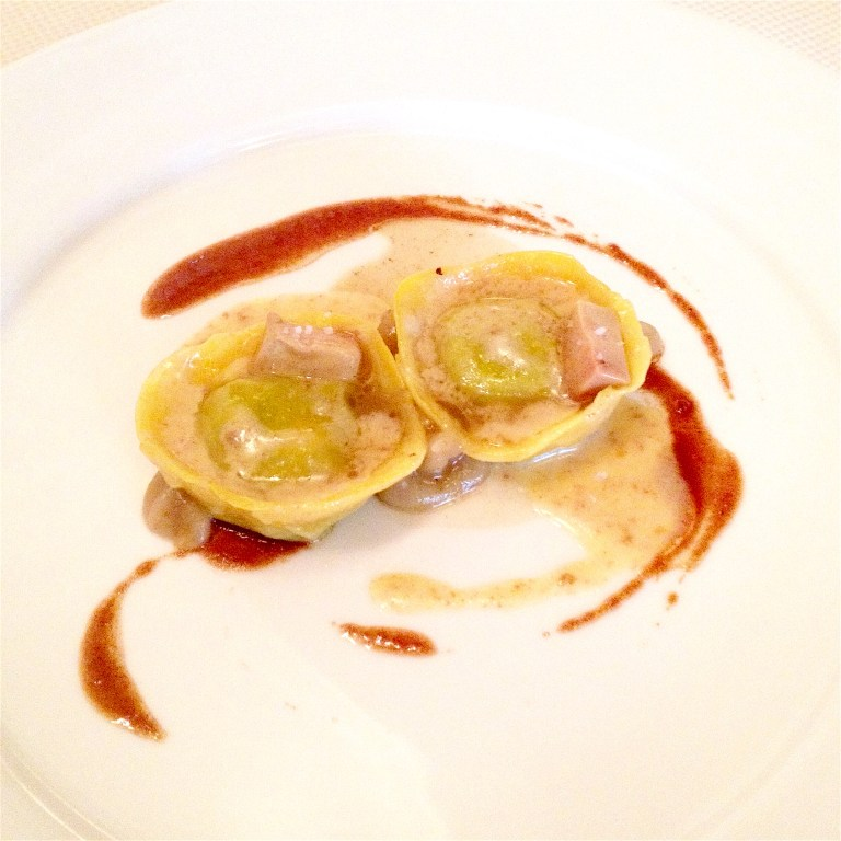 Ravioli with cottage cheese and pistachio, cooked cream, sauce from veal tail , baked pear cream and raw foie gras