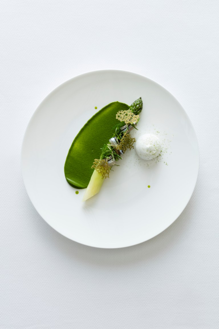Jerome Galis green asparagus with raw & marinated kibinago, seaweeds, nori purée, seawater foam & matcha. Photo: Andrew Loiterton