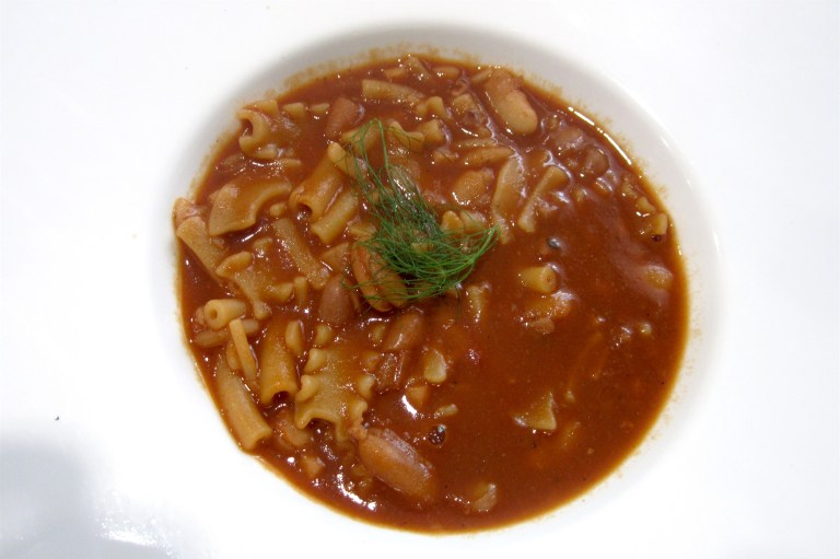 Mixed pasta soup with squid and cannellini beans