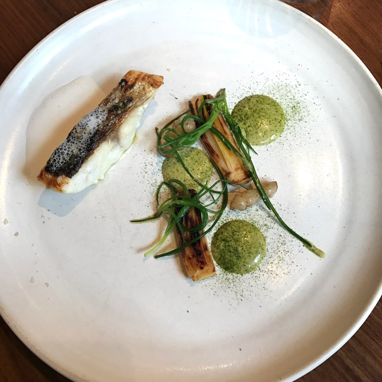 Hazelwood grilled seabass, calçot onion, cinnamon & curry leaf