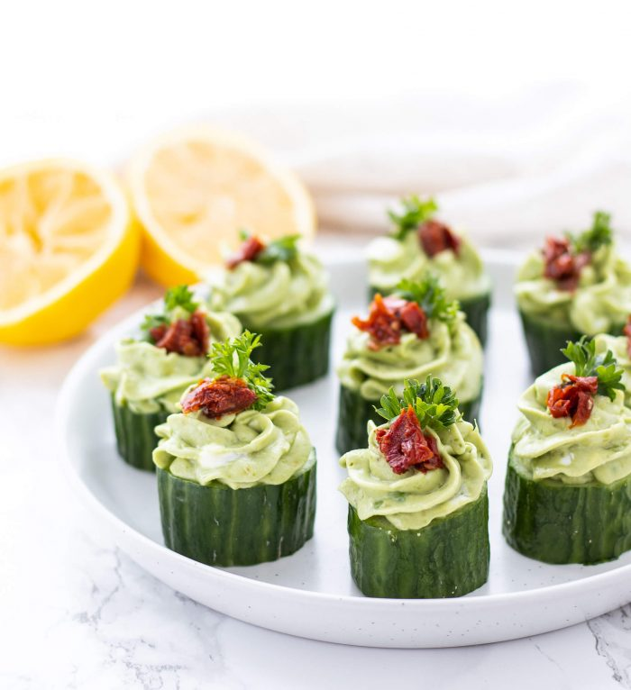 avocado goat cheese cucumber appetizer bites on a plate
