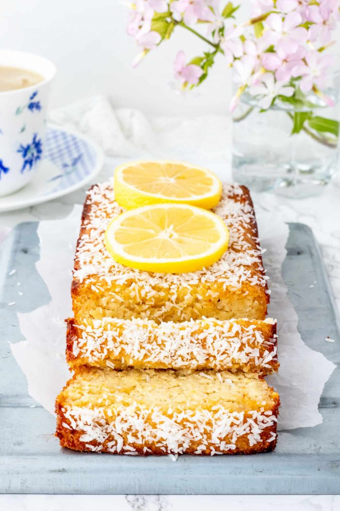Finished lemon loaf on a tray sliced into pieces