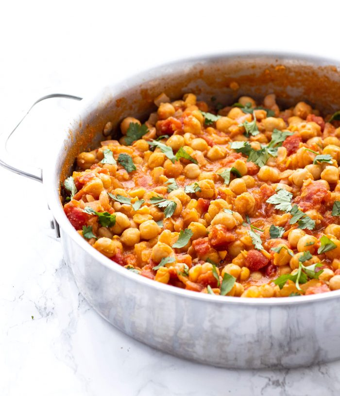 side view of chickpea curry in a saucepan