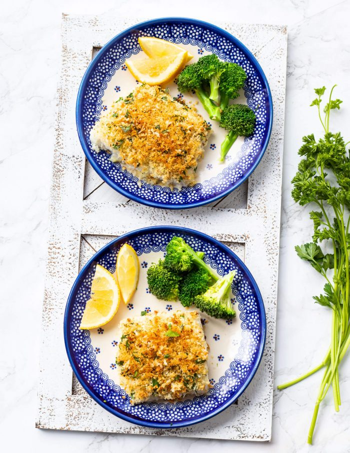 parmesan crusted cod on plate with broccoli and lemon