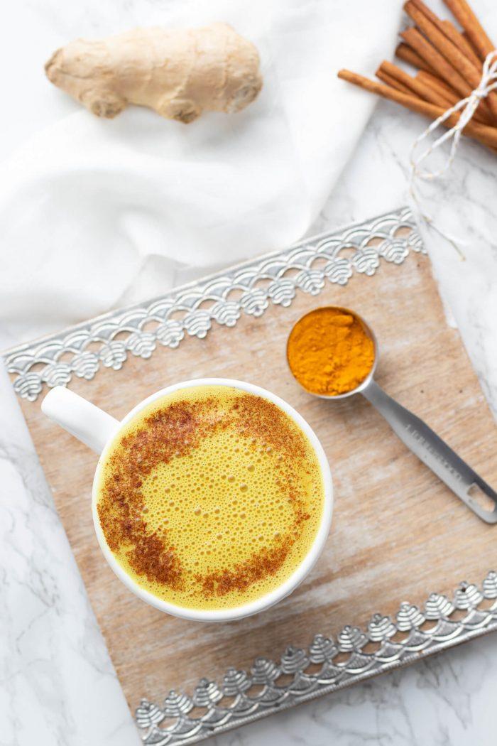 turmeric latte with spoonful of turmeric