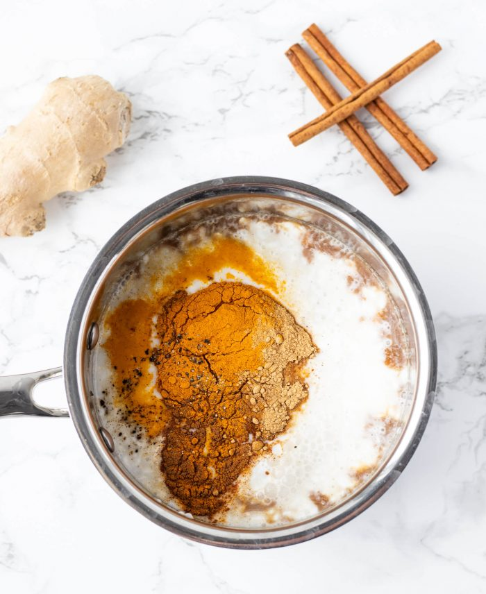 spices and milk in saucepan