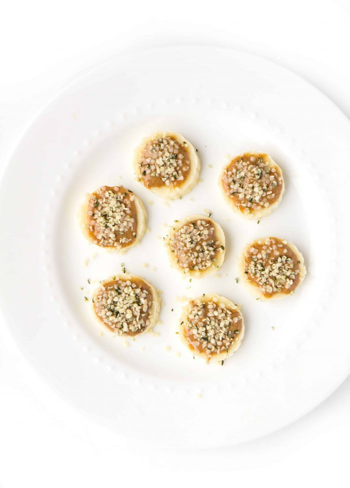 almond butter and hemp hearts on banana slices