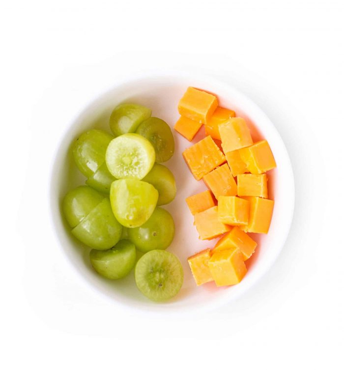 grapes and cheese in a bowl