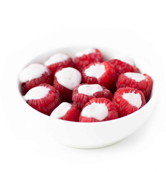 yogurt filled raspberries in a bowl