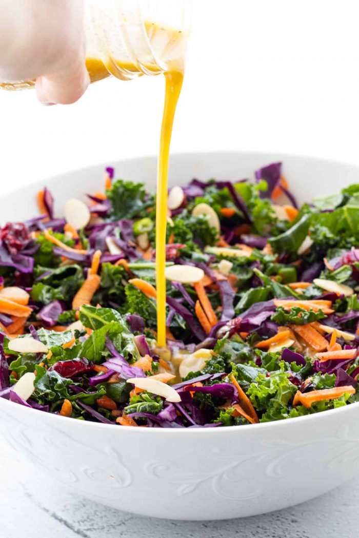 pouring dressing on salad