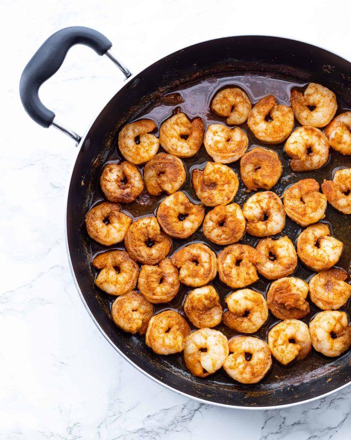 Shrimp cooking in a skillet