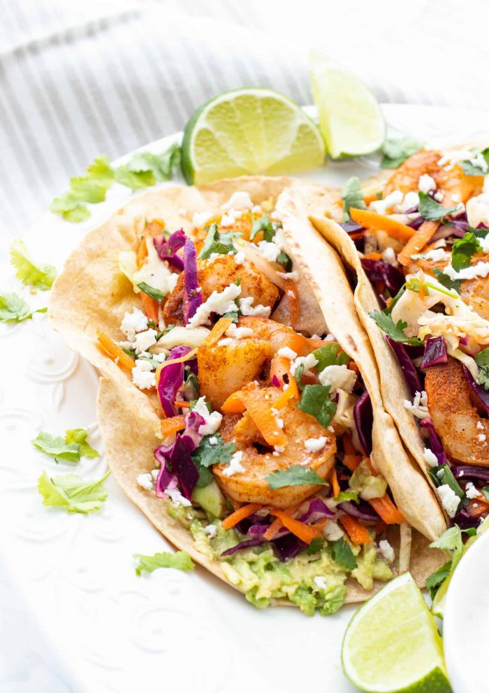 spicy shrimp tacos served with lemon wedges