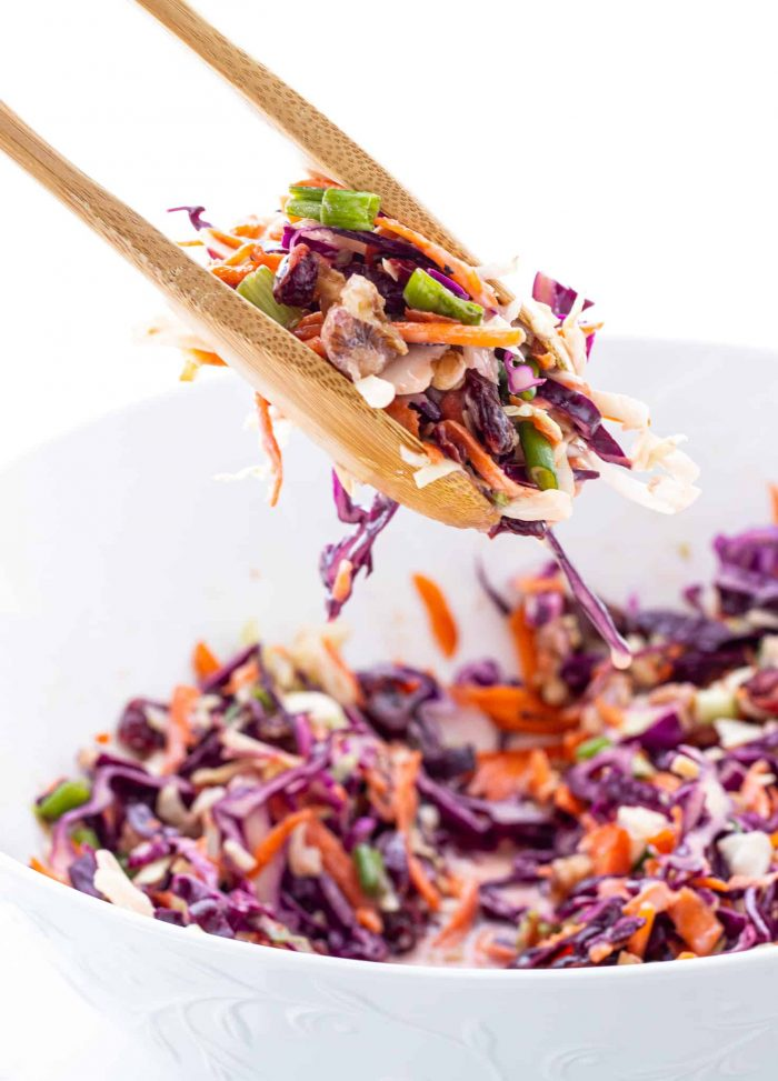 serving coleslaw with tongs