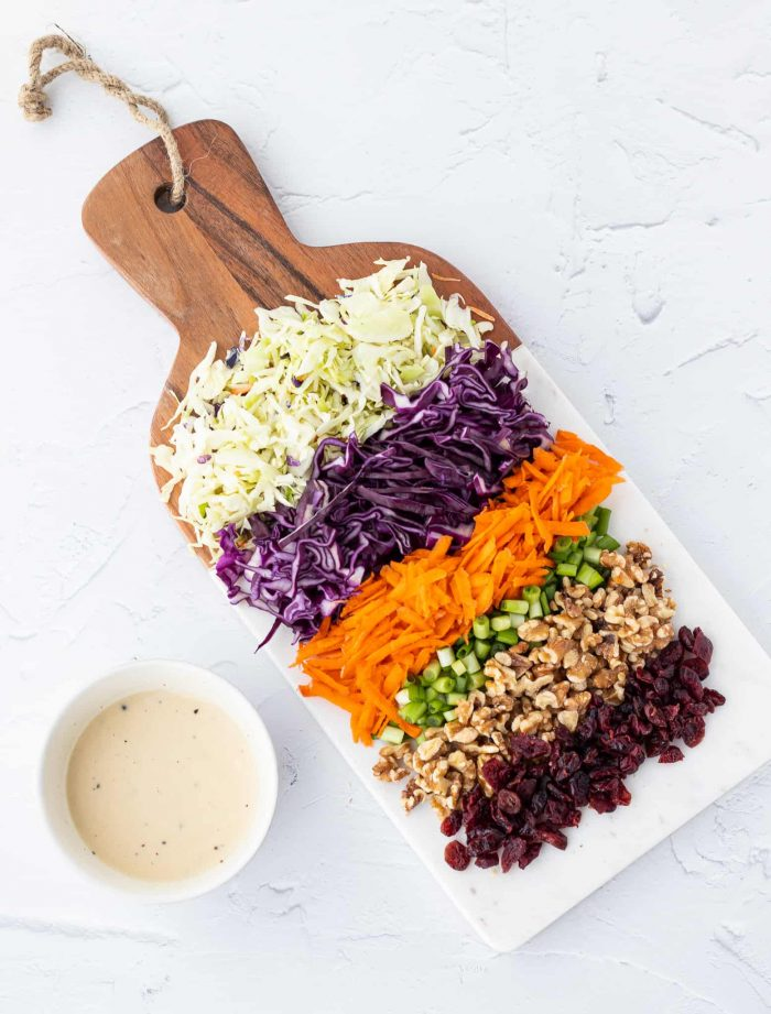 ingredients for coleslaw on a cutting board