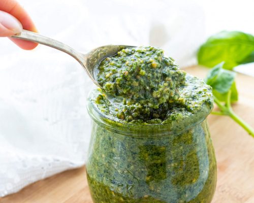 Pesto in a glass jar and on a spoon