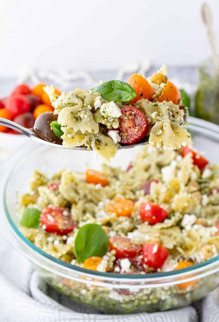 Pasta salad being served with a spoon