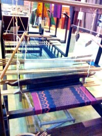 Silk production process in final stages, being woven on hand looms