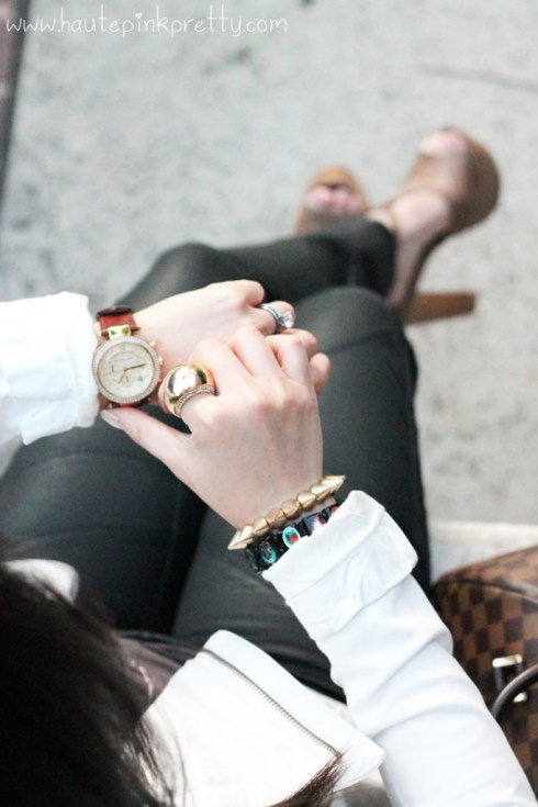 An Dyer wearing Bebe Asymmetrical Leatherette Jacket, Zara TRF Waxed Effect Trousers, Forever 21 Geometric Tee & Rhinestoned Dome Ring, Marc Jacob Heart Mirror Necklace, Jessica Simpson Dany in Coffee Summer Haze, Michael Kors Parker Chronograph Leather Watch, Louis Vuitton Ribera Mm, Spiked Bracelets