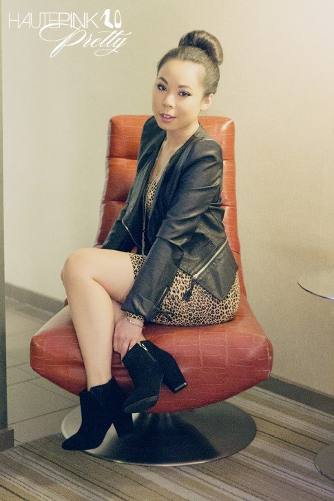 An Dyer wearing Black Faux Leather Zipper Jacket with accent shoulders, H&M Leopard Print Dress, ShoeMint Esther Boots