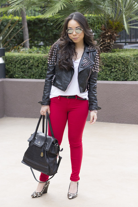 www.HautePinkPretty.com - An Dyer wearing Insane Jungle Heavy Metal Studded Spike Jacket, Michael Stars V Neck Tee, YMI Jeans Red Hyperstretch Skinny Jeans, Sole Society Kelly Wedges, Cole Haan Brooke Tote bag, Mirrored Aviators, ShopLately Glint & Gleam Jewelry