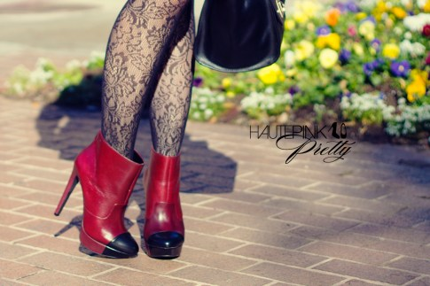 An Dyer wearing Jessica Simpson Collection Essas Burgundy Belluci Boots with Rose Printed Black Tights