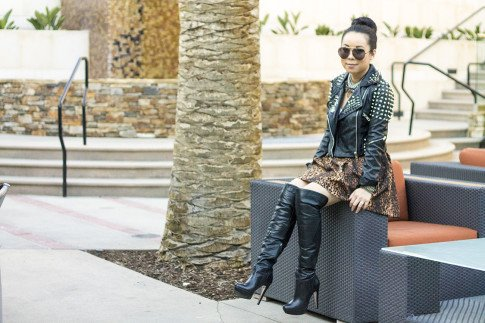 An Dyer wearing spiked leather moto heavy metal Insane Jungle Jacket, Zara Leopard Skirt, White Tee, OTK Over The Knee Leather Boots, Coco Rocha Collection for Senhoa, Celine Aviators