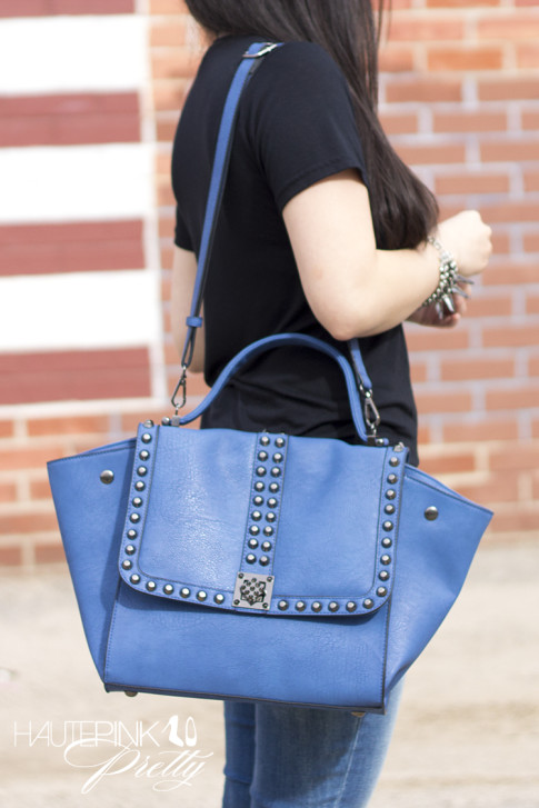 An Dyer wearing Ditto Brand Jeans, Melie Bianco Villette, Coco Rocha Senhoa Jewelry, Black Tee