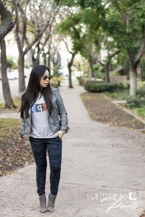 An Dyer wearing NPR Sweatshirt Tee by Chaser Brand, Zara blue camo pants, SoleSociety Aster Boots, Grey Perforated Leather Moto Jacket, Mirrored Aviators, Glint & Gleam Love Silver Bracelets ShopLately