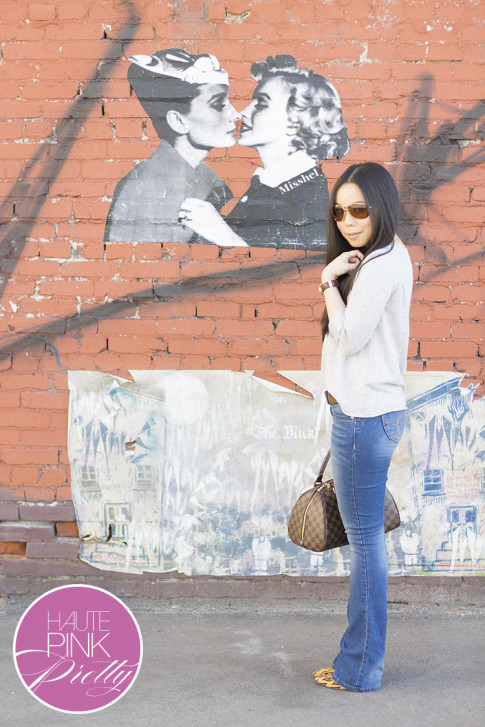 An Dyer wearing  YMI Want a Better Booty Boot Cut Jeans, Michael Stars Soy Cotton 3 4 Slv Wide Neck Pullover in Abalone,Sole Society Fergie Tribal Leopard, Vaunt Eyewear, Louis Vuitton Ribera