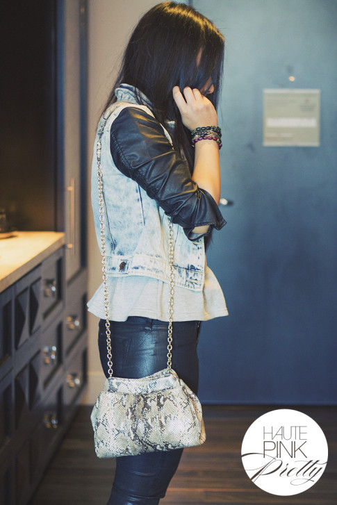 An Dyer wearing Maurie & Eve Heather Grey Peplum Top, Bleulab Coated Black reversible jeans, Vivienne Kelly Necklace, Zara Acid Washed Denim Leather combined Jacket, Koret Python Clutch Purse