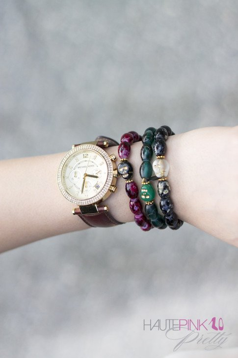 An Dyer wearing Michael Kors Parker Leather Watch, Haute Betts Skull Bracelets