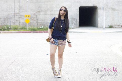 An Dyer wearing Michael Stars Navy Sweater, YMI American Flag Shorts, Haute Betts Bracelets, rubyandjenna Snake Print Wedge Sneaker, Olivia & Joy Controversy Tote, Glint & GLeam Cross Necklace 2