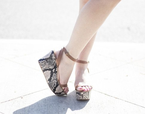 An Dyer wearing ShoeMint Emese Flatforms
