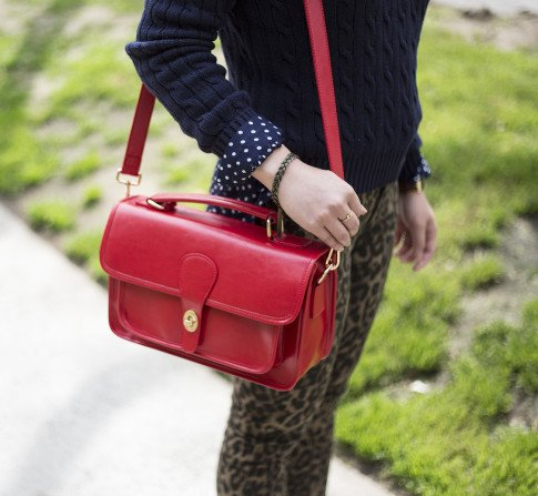 An Dyer wearing Sole Society Britt Messenger Bag in Red, Big Star Leopard Skinny Jeans, Navy Polka Dot Blouse,  American Apparel Navy Cable Knit Pul