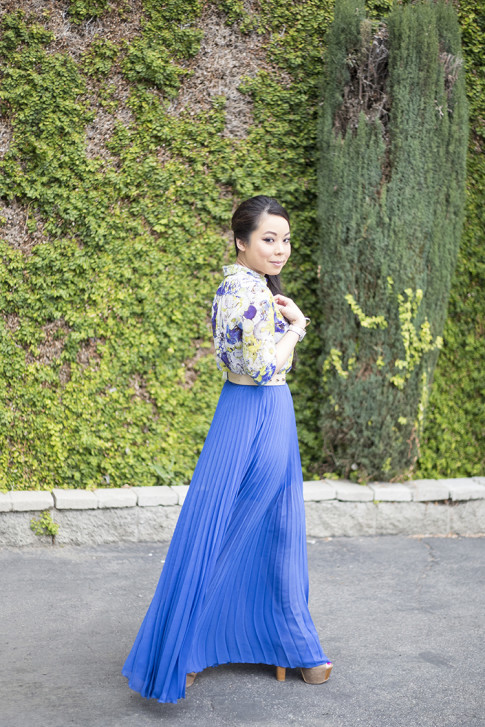 An Dyer wearing Bebe Pleated Long Skirt Maxi Skirt in Nautical Blue Cobalt, Zara Blue Floral Blouse, Asos Studded Plate Belt, Jessica Simpson Dany Platforms