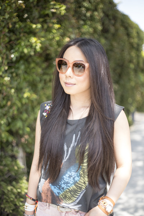 An Dyer wearing Celine Paris Audrey Sunglasses in Pink & Vintage Havana Eagle Tee