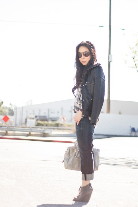 An Dyer wearing Fidelity Denim Girlfriend Jeans in River Blue, ShoeMint Jordane Mushroom, Frederick's of Hollywood Grey Satchel, Vaunt Snake Print Aviators, DKNY Leather Jacket