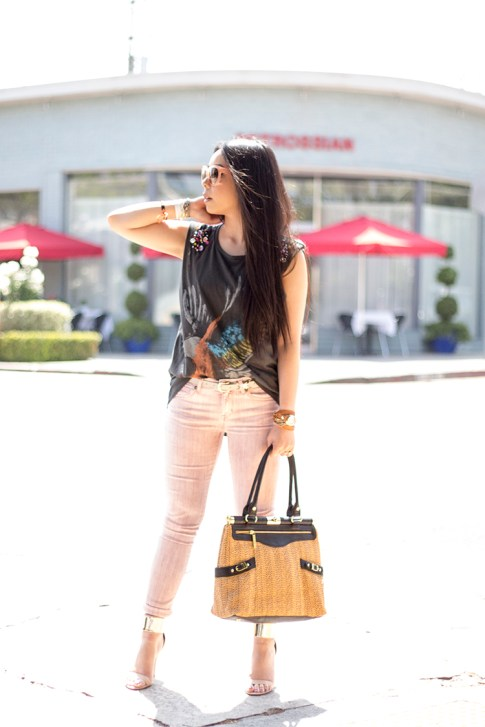 An Dyer wearing Rich & Skinny Jeans Skinny Ankle Peg in Piglet, Bebe Jacqueline Metal Cuff Stilleto Sandals, Celine Paris Audrey Sunglasses, Olivia & Joy Swanky Straw Satchel, Vintage Havana Eagle Tee