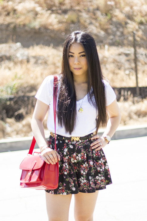 An Dyer wearing ShoeMint Lulu Nude Suede Pump, Sole Society Britt Red Satchel, BCBGeneration DIY Custom Affirmation Bracelets as a Belt, Michael Stars VNeck, Forever 21 Floral Shorts