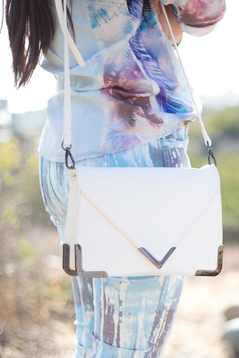 An Dyer wearing BleuLab Drip Tie Dye Ocean, Sole Society Elsie Bag in White, Zara Denim Tropical Combined Shirt